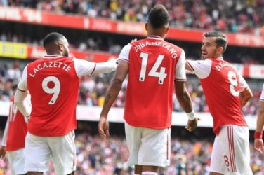 Watford face Arsenal at Vicarage Road. Alex Lacazette celebrates with Dani Ceballos and Pierre-Emerick Aubameyang.