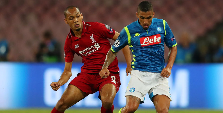 Liverpool's Fabinho puts Allan under pressure while playing Napoli in the Champions League.