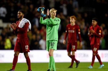 Caoimhin Kelleher and Joe Gomez applaud the fans after defeating MK Dons in the Carabao Cup