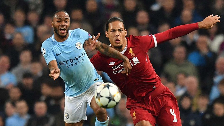 Raheem Sterling of Manchester City and Virgil van Dijk of Liverpool tussle for possession