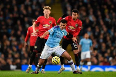 Rodri holds off Scott McTominay and Jesse Lingard in the League Cup Semi-Final.