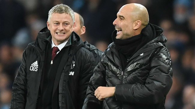 Ole Gunnar Solskjaer and Pep Guardiola smile on the touchline