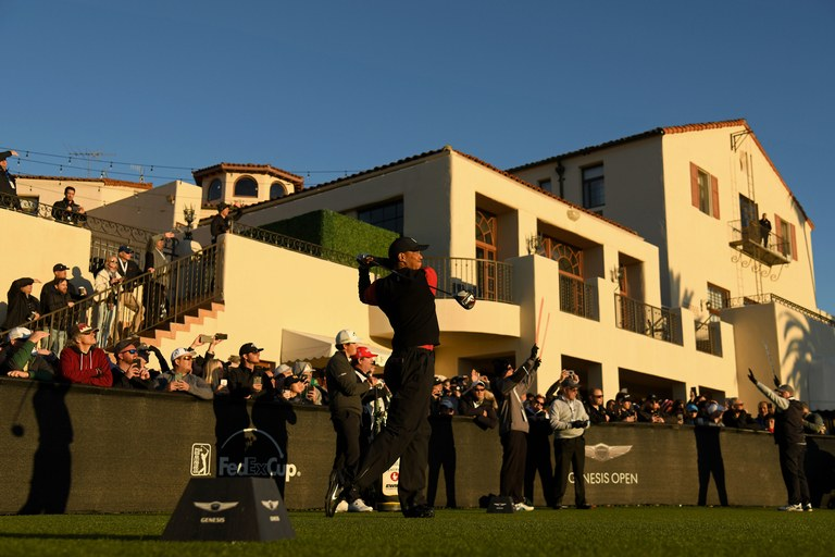 Tiger Woods tees off at the Genesis Open