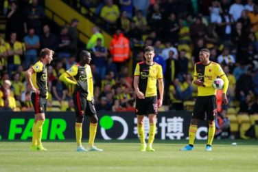 Watford players look dejected after conceding to Brighton.