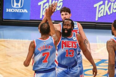 James Harden and Kevin Durant celebrate during his Brooklyn Nets debut