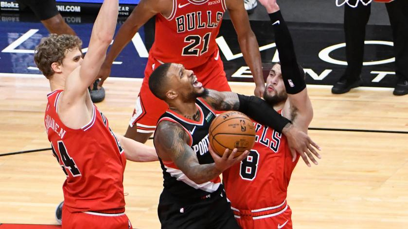 Damian Lillard finishes against the Bulls